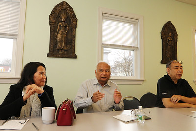 Survivors of the Khmer Rouge genocide in Cambodia, from left, Neang Heng, Ren Sar, and Bunchhoeun Noun, all of Lowell, talk about their experiences.  (SUN/Julia Malakie)