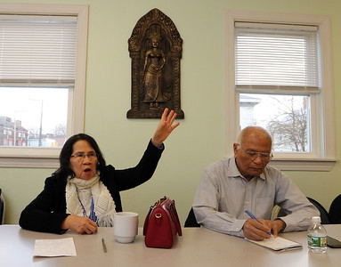 Survivors of the Khmer Rouge genocide in Cambodia, from left, Neang Heng and Ren Sar, both of Lowell, talk about their experiences.  (SUN/Julia Malakie)