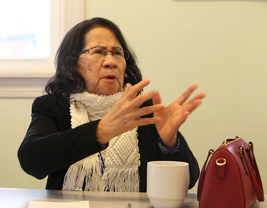 Survivor of the Khmer Rouge genocide in Cambodia, Neang Heng of Lowell, talks about her experiences.  (SUN/Julia Malakie)