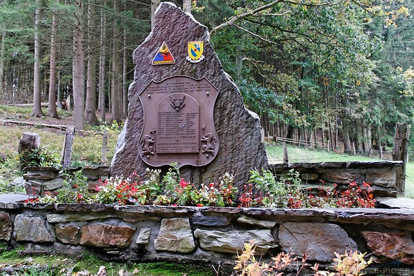 Here where the monument stands, unknown SS men took twelve American prisoners and three local civilians and murdered them in cold blood. Later, as the battle wound to a close, local villagers searching for the missing civilians discovered the bodies. The GIs lay where the monument now stands and the civilians across the trail where a wooden bench marks the spot. The murdered soldiers were men of Company A, 27th Armored Infantry Battalion of the 9th Armored Division. This unit would earn itself a place in history a few months later when, under Captain Karl Timmermann, it jptured the Ludendorf Bridge over the Rhine River at Remagen. <br /> Note the swedish flag and name.