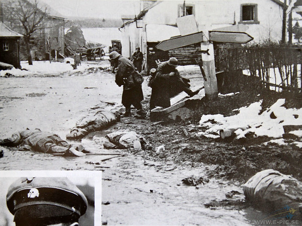 Some of the most well-known photographs taken during the battle are those showing three dead GI's lying face down in the mud in front of this trough as German soldiers try on the dead men's boots. <br /> Roger Foehringer well remembers passing those dead Americans: 'There were several [three] bodies lying in the road, it was hard to visualise that these were bodies because so many German vehicles had run over them. We tried to avoid walking on them, they were like pancakes, but the Germans made us valk over them.'