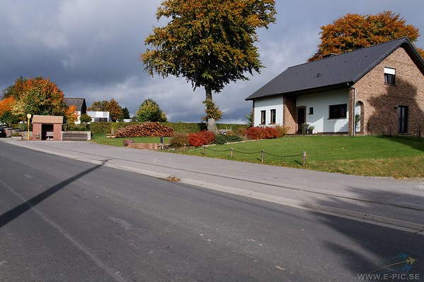 Here and in the yard of the house just before the cemetery, soldiers of the Kampfgruppe Peiper murdered Americans they'd already taken prisoner. One of the SS men (not identified) involved in killing the men as they exited the farmhouse, bragged about it later in front of a local teenager who later testified of hearing this when called to the post-war trial of surviving members of the Kampgruppe Peiper. Unknown SS men also murdered a teenage girl named Erna Collas.