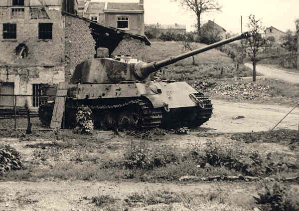 We saw the long tube of the Tiger's 88mm gun emerge from behind the last building.  The M-10 gunner must have been tracking the tank with his telescopic sight, for as the Tiger cleared the building, the M-10 fired one round of armor piercing shot which penetrated the armor on the right side above the track, about 14 inches under the turret and four to five feet to the rear of the front glacis plate.  The Tiger stopped in its tracks... Surprisingly the tank did not burn.