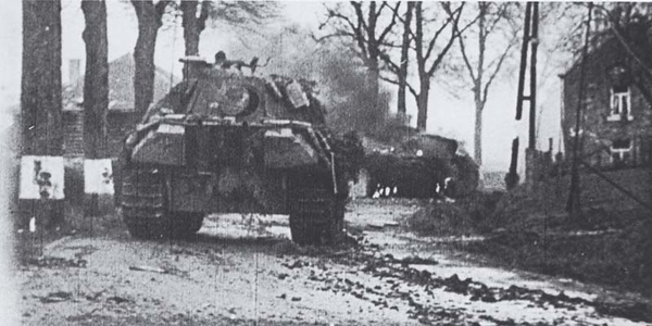 The half-timbered houseexisted in 1944 and features prominently in film and photographs taken by German combat photographers during the battle for Stoumont. The house is just tho the left of the tank turret.