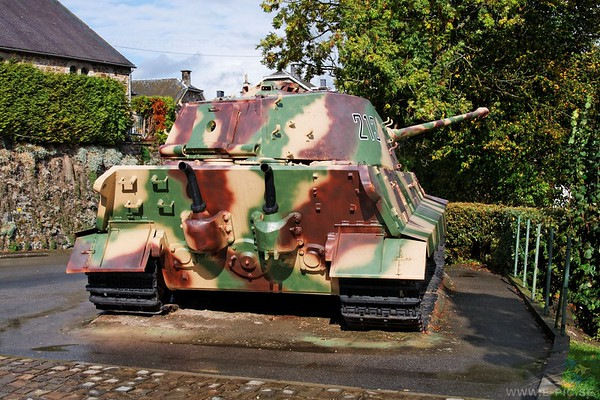 """The crew of Tiger 211 abandoned their tank after several hits to the turret knocked out the sensitive electrical firing system and the tank commander, SS-Untersturmführer Hantusch, was wounded in the head.  Shortly afterwards the crew of Tiger 213 followed suit after accurate American fire blew off the front third of the tank's gun.  Darkness brought McGeorge's advance to a halt, but the day's actions had seen three of the Königstigers in La Gleize put out of action.  As Rolf Ehrhardt put it, """"Our trump card had failed when we needed it most.""""  Peiper was trapped in what the Germans called the """"cauldron"""" of La Gleize.  The Americans mounted no strong attacks on 23 December, but continued their intense artillery fire.  German tank fuel and ammunition were exhausted.  Peiper, unable to advance further and knowing that he would get no relief, had begun the day before requesting permission from 1. SS-Panzerdivision to withdraw.  Radio contact was sporadic, and the answers Peiper received convinced him that the division did not realize the severity of his situation.  One radio message notified him that six Königstigers were operational at Stavelot and asked where they should be sent.  """"By airdrop to La Gleize"""" was Peiper's aggravated answer."""
