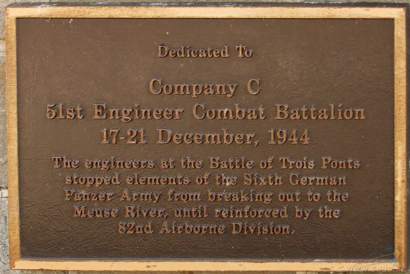 the plaque on the wall of the bridge commemorating the role of Captain Sam Scheuber's Company C, 51st Engineer Combat Battalion in the defense of Trois Fonts.