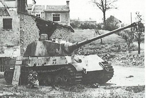 Tiger 222 Knocked out just yards from the bridge. Notice the holes from the armour piercing projectiles just above the tracks in the side armour.