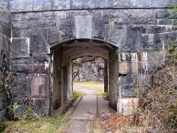 Entrance to the fort with the kings seal above the gate.