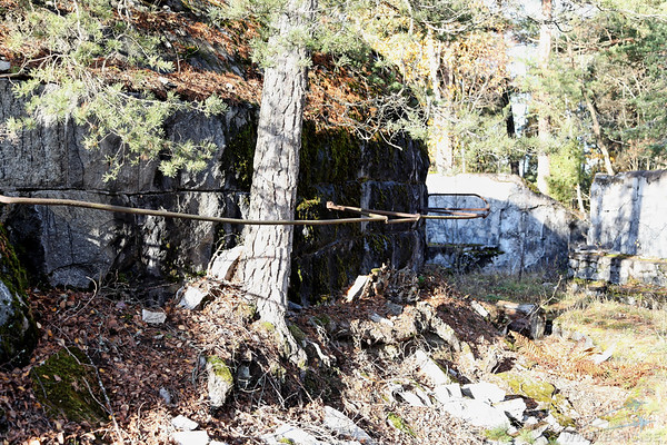 What is this? Its behind the wall and out of sight from outside. One theory is that camouflage was attached to the rails but ther were no aircraft at that time.