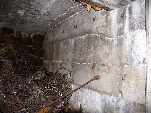 The hooks in the walls were used to secure hammocks for the soldiers to sleep in.