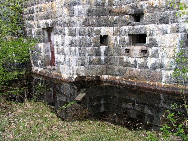 Caponier battery with cannon port and machine gun ports. Note the water filled moat in front.