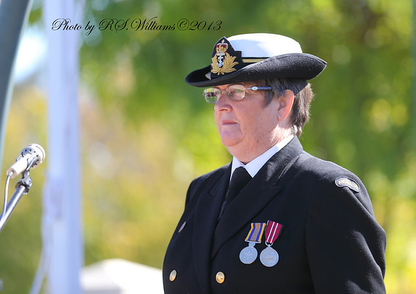 RAN Cdr. Carmel Barnes awaits the arrival of the marchers, Anzac Day 2013.