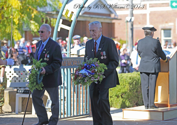 Former Australian National Servicemen Derrick Mason (left) and Ron Morgan (right) move up to lay the wreaths on Anzac Day 2013.