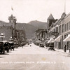 "Here's a photo you'll certainly want to click on in order to select a larger image.  Taken in about 1920, it shows Main Street in Deadwood -- looking South -- and there are several noteworthy items:  the horse and rider mid-way up the street on the left; and the gravity-fed fuel pump on the right (west) sidewalk.  We're particularly curious about the tall building on the left mid-way up Main Street (the one with the flag on top!)  If you can help, please drop us an <a href=""mailto: galeymedia@gmail.com""><b><i>E-Mail</i></b></a>.  Thank you!  (Photo courtesy of Jerry Bryant/Deadwood)."