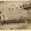 Title: Deadwood. Grand Lodge I.O.O.F. of the Dakotas, resting in front of City Hall after the Grand Parade, May 21, 1890<br /> Group of uniformed men posing in front of a large brick building.<br /> Repository: Library of Congress Prints and Photographs Division Washington, D.C. 20540 From the John H.C. Grabill Collection, Library of Congress, Washington, DC