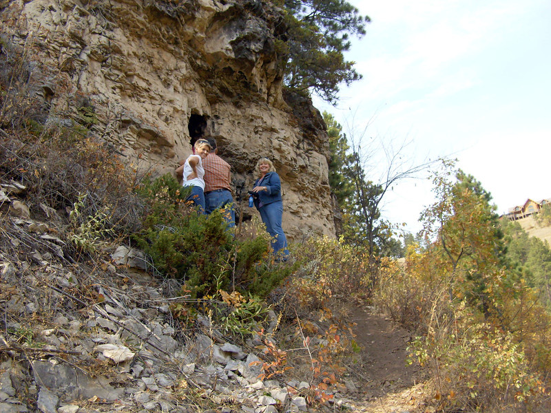 Participants navigate their way to Barker's Cave, a small 8' x 8' cave perched on the side of Whitewood Creek canyon.
