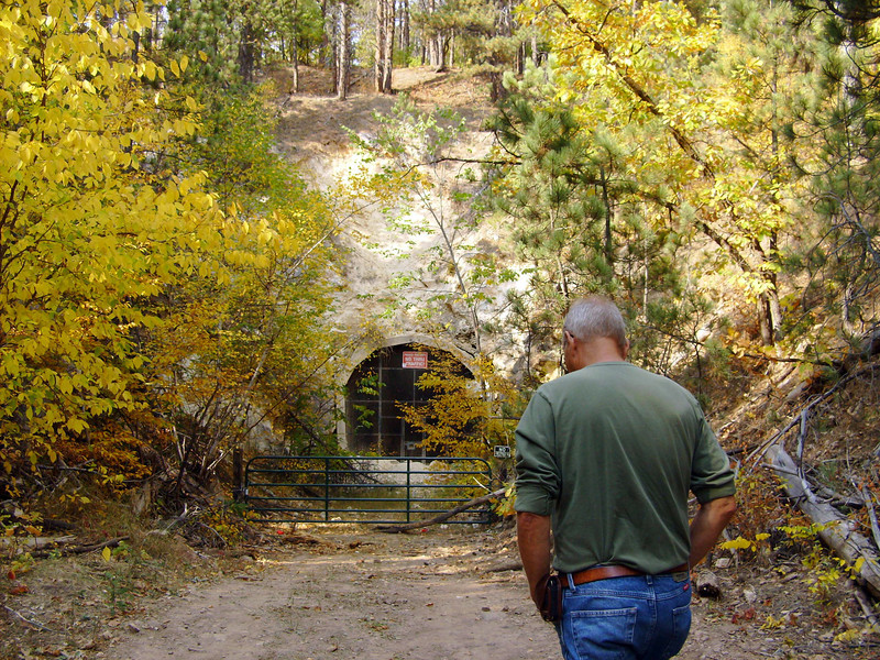 """The old C& NW railroad tunnel along Whitewood Creek is now closed off, but one can still see there is a """"light at the end of the tunnel.""""  One of the participants talked about her taking her Brownie Troop through the tunnel years ago.  It is approximately the length of two football fields.        Return to <a href=""""http://www.lawrencecountyhistory.blogspot.com/2012/09/more-than-100-persons-participate-in.html""""><b><i>2012 Fall Tour</i></b> story</a>  Return to <a href=""""http://www.lawrencecountyhistory.com""""><b><i>LCHS Historical Marker</i></b> web site</a>"""