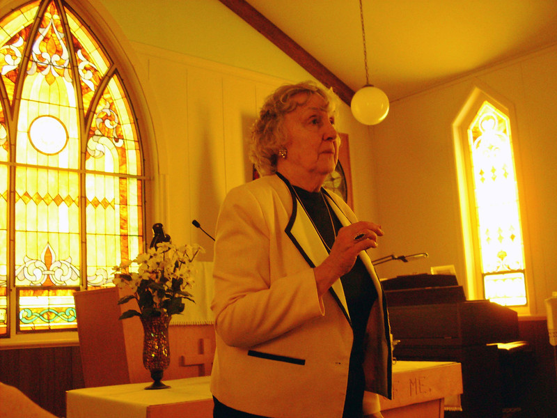 Mary Gallup-Livingston provided details about the many stained glass windows in the church.  Photo courtesy of Norma Kraemer.