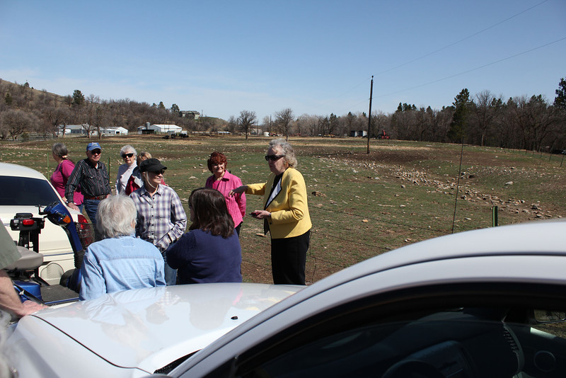 That's Mary Gallup-Livingston  in the yellow jacket.  She led the organizing of arrangements in Whitewood for this great tour.  Thank you, Mary!  Here, she prepares to guide our group in to Whitewood, which was a very busy place on Saturday, April 27th!  They had a major auction taking place that day.
