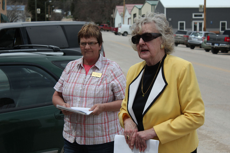 Whitewood Mayor Deb Schmidt (left) welcomed the group to Whitewood -- and talked a bit about some of the structures along Meade Street.  Mary Gallup-Livingston is at right.