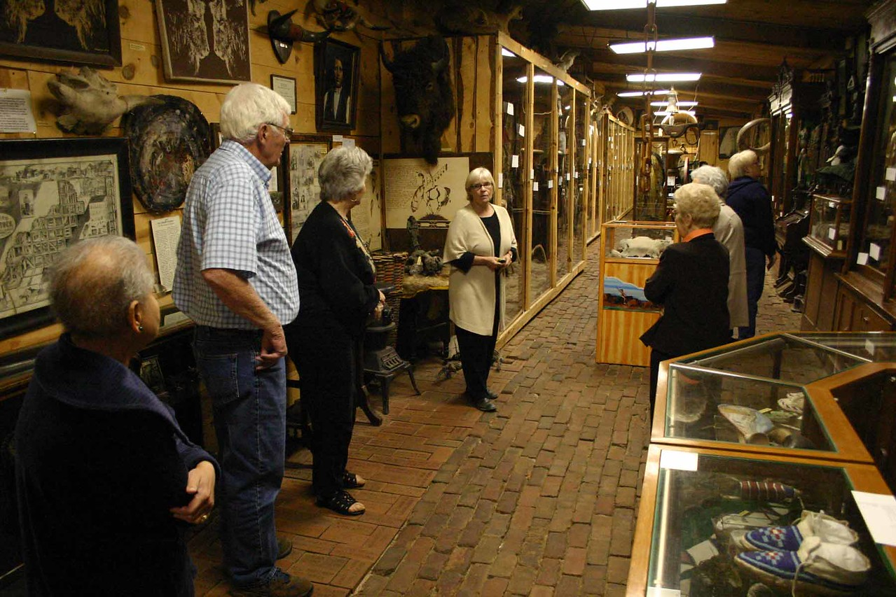 Deb Gangloff (center) led our tour of the old museum.  Note the brick floor.  The building is scheduled to be demolished next month (November, 2009).