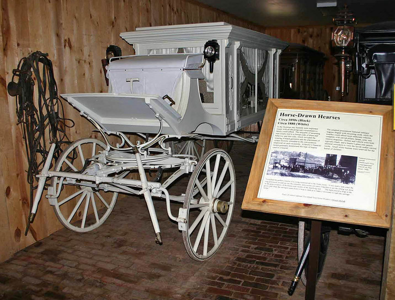 More than 50 old horse-drawn wagons are a major part of the museum inventory.  Here's a horse-drawn hearse.