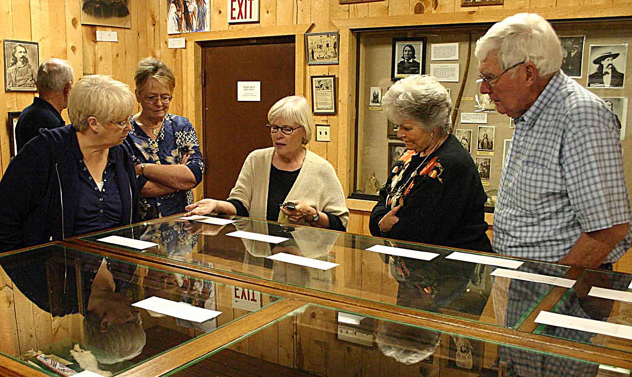 "Deb Gangloff (center) demonstrated keen insight into the many museum exhibits.  Mattson credits her with obtaining many generous grants, including a $250,000 grant from the Bush Foundation.        Return to <a href=""http://lawrencecountyhistory.blogspot.com/""> HISTORICAL MARKER</a>."