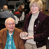 <b>JACKE MITCHELL HONORED BY LCHS</b> Lawrence County Historical Society Treasurer Jacke Mitchell shows off an engraved coffee cup presented to her at the LCHS spring meeting (March 30, 2014) as a small token for her long and dedicated service to the society.  Her husband, Milton, also a long-time member, is at her side.