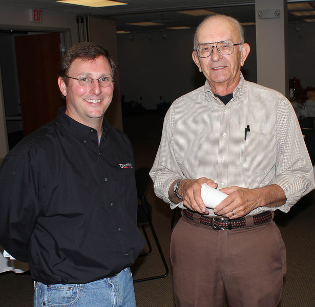 <b><i>SPANISH CANNON and USS MAINE SHELL October 21, 2012</i></b>  After his presentation to the Lawrence County Historical Society on Sunday, October 21st, Deadwood City Archivist Mike Runge (left) chatted a bit with LCHS Life Member Ivan Hovland.  As we have done for the past several meetings, members and guests enjoyed a superb buffet luncheon provided by Dave Brueckner and the other good folks at the Stage Stop Cafe at Cheyenne Crossing.