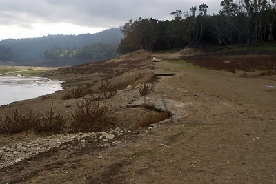 More deep silt covering the old roadbed, looking downstream.