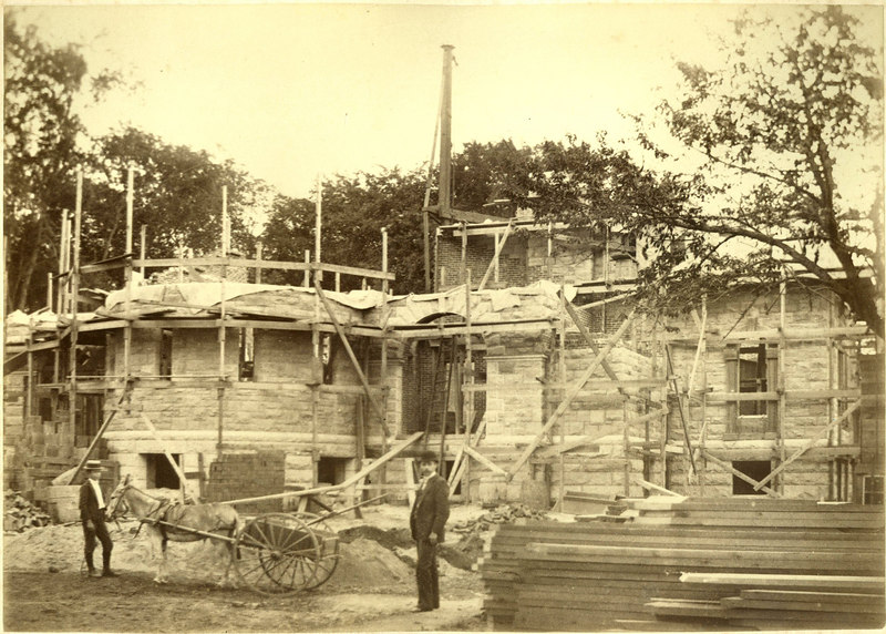 Library under construction.  I believe it's Henry H. Rogers (Junior) with the donkey.