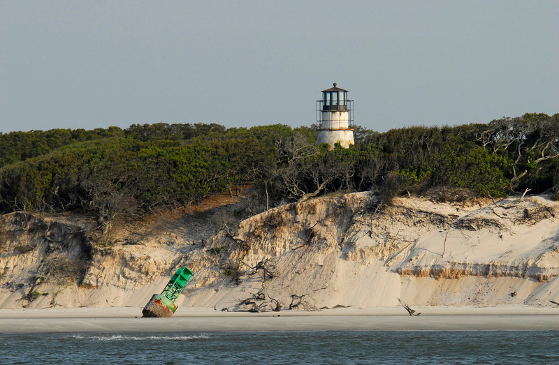 Little Cumberland Lighthouse on Little Cumberland Island as viewed from the ICW in St. Andrews Sound in Georgia with Buoy
