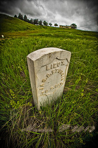 One of the stone markers at the Little Bighorn battlefield. Generally the markers are where they found a dead trooper. This is verified by the presence of fragments of human remains under many of the stones. This stone is unusual in that they never found his body. The stone is the location of a spurious grave that was fashioned to photograph so that his mother might have a picture of her son's grave to comfort her.