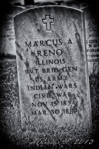 Major Marcus Reno's gravestone. He was second in command of the 7th Cavalry on 25 June 1876. His attack on a village of some 7,000 with about 125 men descended into pandemonium when the Indians resisted vigorously.