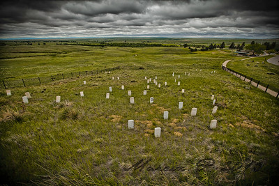 "Looking down Last Stand Hill from the Monument. Ahead is Deep Ravine, where the last of them headed in a desperate attempt to escape their dire predicament. To the right is Cemetery Ridge and beyond is ""The Flats"" by the river where Custer glimpsed his quarry, the women, children and the aged from the village who had fled to the north end after Reno's attack. Custer didn't press home his attack at that moment as he was expecting Capt. Benteen and the pack train to arrive to reinforce him. Unfortunately for him, Benteen was tied up with another matter."