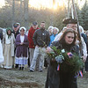 Annual Patriot's Day ceremony at Liberty Square in Littleton, where minutemen mustered to march to the battle in Concord. Littleton Historical Commission member Donna White, with Boxborough District Minutemen Company members Andrew Sammarco of Littleton, left, and Ralph DeMent of Boxboro, right rear, carries a wreath to the monument to Littleton's Revolutionary War heroes. (SUN/Julia Malakie)