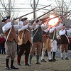 Annual Patriot's Day ceremony at Liberty Square in Littleton, where minutemen mustered to march to the battle in Concord. Boxborough District Minutemen Company members fire a salute. (SUN/Julia Malakie)