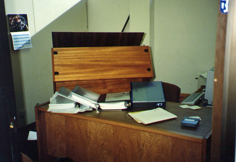 At the office the next morning, we could see why it's a good thing to duck under your desk or other solid object when an earthquake hits.  Dozens of tall bookcases, like this one, landed where people had been sitting not long before. (Who ever thought about fastening bookcases to the walls?)