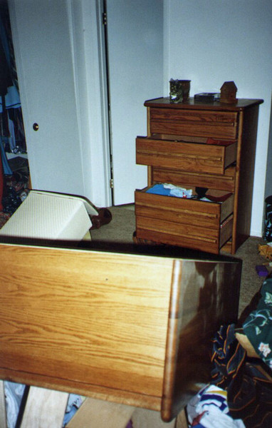 In our bedroom, the heavy wardrobe against one wall had been flung across the room across the foot of the bed. The heavy bureau against a 90-degree different angle wall had its drawers opened, but remained upright with knick-knacks still sitting undisturbed.