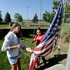 """Alexa Brolsma, left, and Amelia Dillow, raise the flag at Lone Tree School.<br /> For more photos and a video of the school, go to    <a href=""""http://www.reporterherald.com"""">http://www.reporterherald.com</a>.<br /> Cliff Grassmick / June 13, 2012"""