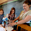 "Peyton Oleson, left, and Kaylee McKie, help teacher, Teri Johnson, prepare cream for butter churning.<br /> For more photos and a video of the school, go to    <a href=""http://www.reporterherald.com"">http://www.reporterherald.com</a>.<br /> Cliff Grassmick / June 13, 2012"