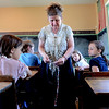 "Teacher Teri Johnson shows the students a braiding technique at Lone Tree School in Loveland.<br /> For more photos and a video of the school, go to    <a href=""http://www.reporterherald.com"">http://www.reporterherald.com</a>.<br /> Cliff Grassmick / June 13, 2012"