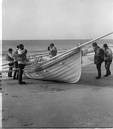 Life saving corps with boats ready for action on Long Island Beach.