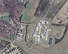 Close-up of Launching Area form recent Gooole satelite photo.  Note buildings that were erected by the prison on or in close proximity to the launcher pads.  One of the Herc sections has been removed to accomodate a loading ramp for the building Beside the three LA administrative buildings, lower left and left of the row of trees, the only original structure left in the LA is the Assembly and Service Bldg at the right rear of the site.  It appears as a bldg with a black roof.