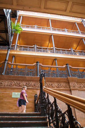 The Bradbury Building, down town Los Angeles, Broadway.  Emily looks for a good photo opportunity.