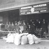 Walker Hardware Store, First street.   Probably demonstrating 1920 tractor, and gasoline powered engine.  Notice belt driven washing machine near the center of the picture.