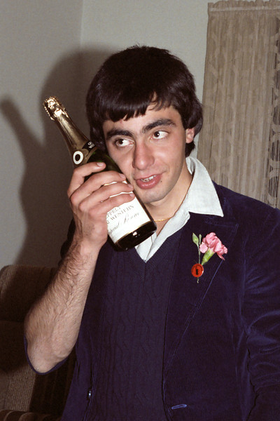 1982 Mark Attard tests whether he can get drunk by placing his cheek against a bottle.