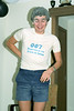 October 1983 Pensioner's Party. In 1983, MAD Treasurer turned the unimaginably great age of 25, so we held a Pensioner's Party for him. John Lenders, wearing the official T-Shirt for Monash 007, (possibly) the first debating team in the world with a slogan: 007, Debating at the Speed of Sound.