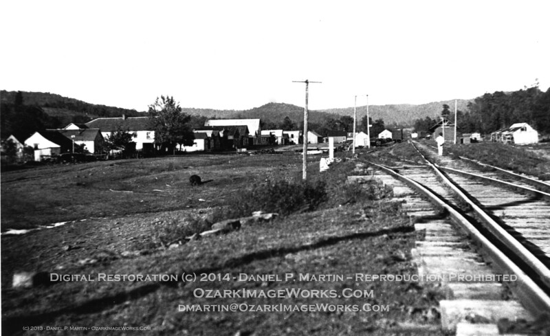 "Pettigrew, AR - mid / late 1930's, looking east along current route of AR Highway 16.<br /> <br /> This picture really tells the story of ""What happened after the boom-town days?"" -- Twenty years earlier, the right-hand side of the image would have been stacked full of milled timber ready for transportation on the railway.  At the time of the photo, the depot freight yard, streets and storefronts are empty.  Grass is growing up along the tracks.  Unidentified boy standing at the siding switch (right-hand, mid-ground in image) looks east toward town and the Boston Mountains.<br /> <br /> Original negative in my collection, from my father's papers.  Shiloh Museum has a copy in their archives.<br /> <br /> Digital restoration (c) 2013 - Daniel P. Martin / ozarkimageworks.com"
