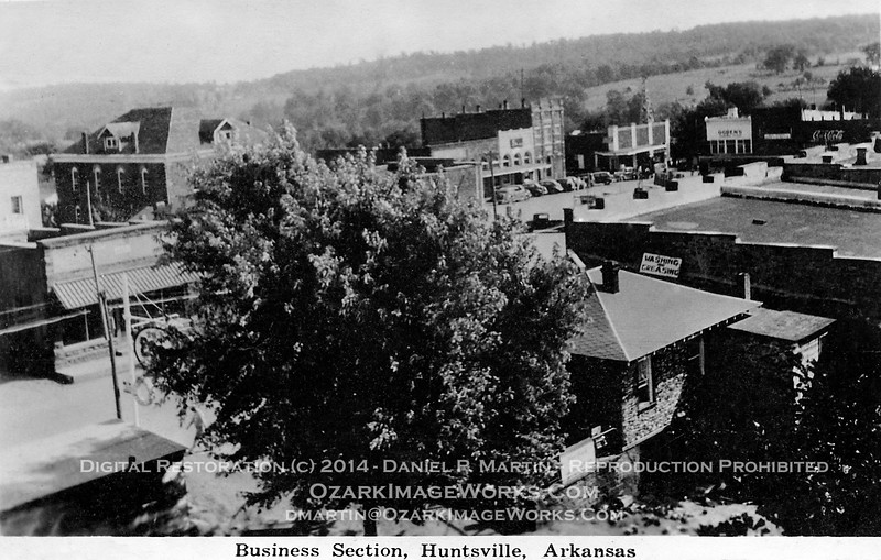 "Postcard - ""Business Section, Huntsville, Arkansas""<br /> <br /> Undated postcard photo of the Huntsville town square - mid- to late-1930's."